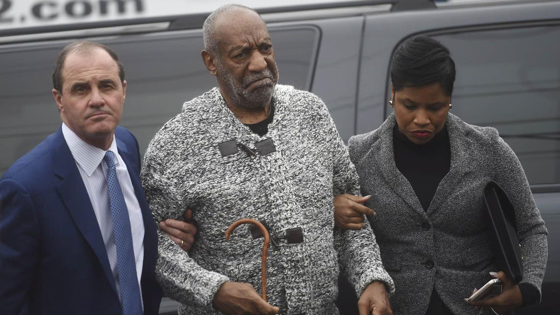 Actor and comedian Bill Cosby (C) arrives with attorney Monique Pressley (R) for his arraignment on sexual assault charges at the Montgomery County Courthouse in Elkins Park, Pennsylvania December 30, 2015.