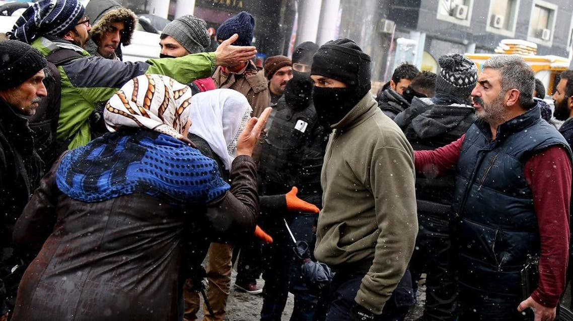 Kurdish demonstrators argue with members of Turkish police special forces during a protest against the curfew in Sur district and security operations in the region, in the southeastern city of Diyarbakir, Turkey December 31, 2015 | Reuters