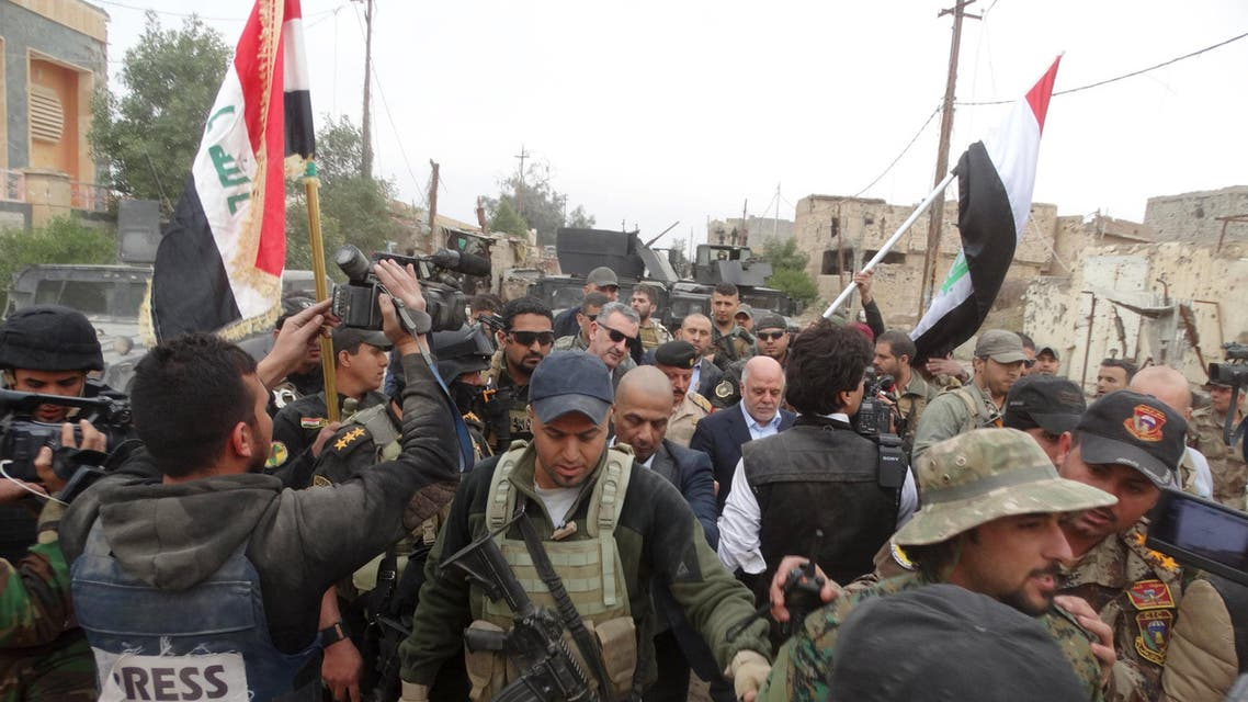 Iraqi Prime Minister Haider al-Abadi walks with his security detail in the city of Ramadi, December 29, 2015. (Reuters)