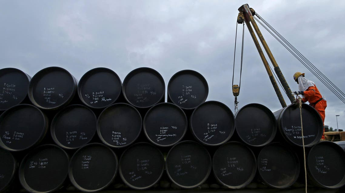 A worker prepares to transport oil pipelines to be laid for the Pengerang Gas Pipeline Project at an area 40km (24 miles) away from the Pengerang Integrated Petroleum Complex in Pengerang, Johor, in this February 4, 2015 file photo. reuters