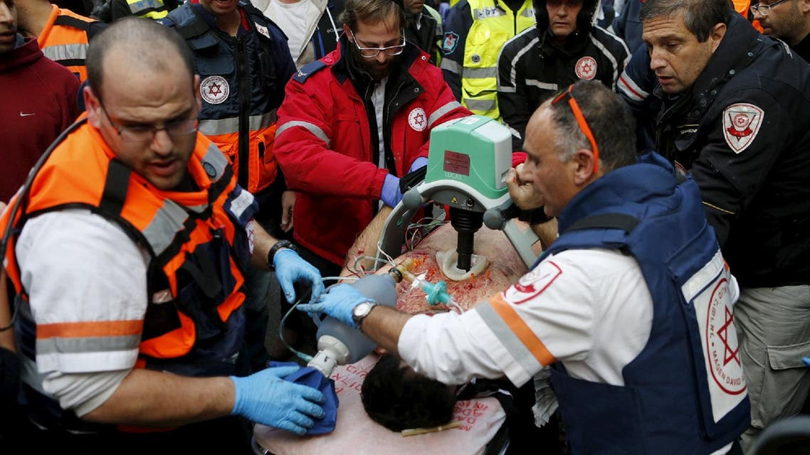 Israeli medics evacuate a wounded person from the scene of a shooting incident in Tel Aviv, Israel January 1, 2016. (Reuters)