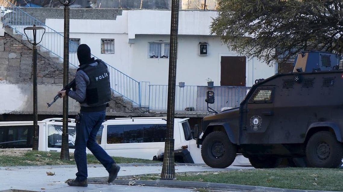 A member of Turkish police special forces secures the area during clashes with Kurdish militants in Yenisehir district of the southeastern city of Diyarbakir, Turkey December 24, 2015. | Reuters