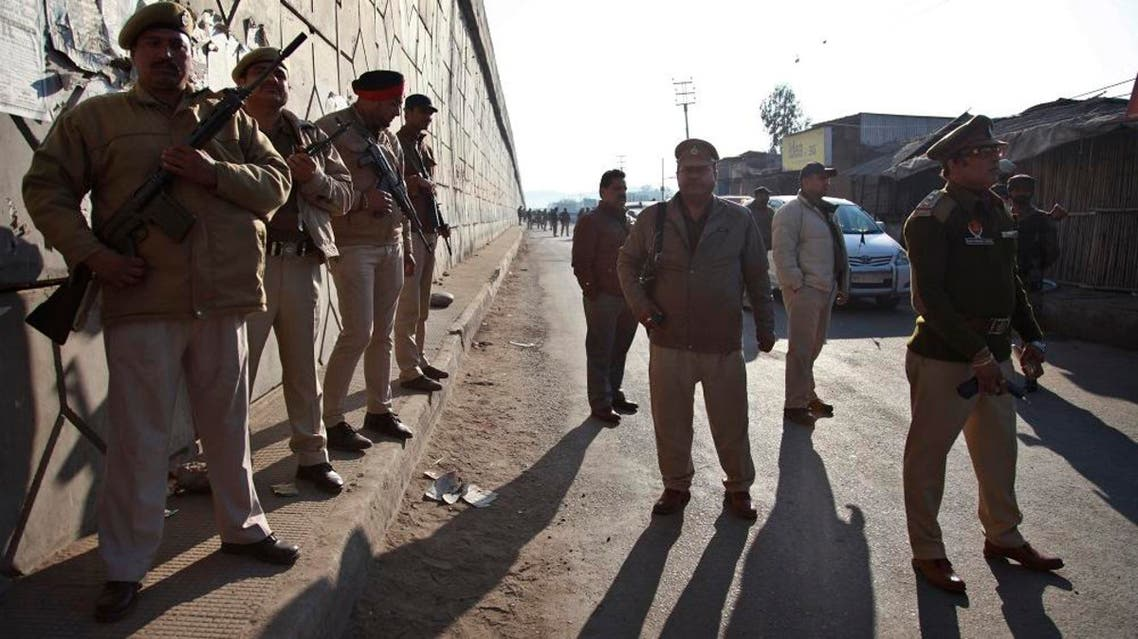 Indian security forces stand outside an Indian air force base in Pathankot, 430 kilometers (267 miles) north of New Delhi, India, Saturday, Jan. 2, 2016. Gunmen attacked the air force base near the border with Pakistan on Saturday morning and exchanged fire with security forces, officials said. (AP Photo/Channi Anand)