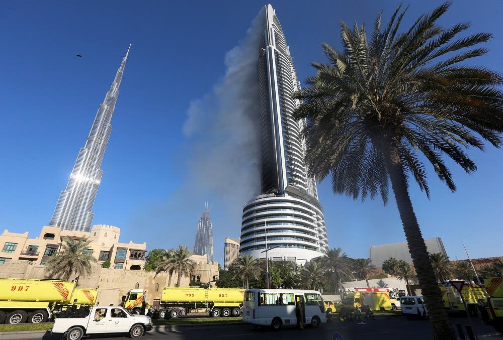 Plumes of smoke rise from the 63-storey Address Downtown Dubai hotel and residential block near the Burj Khalifa, the tallest building in the world, a day after the hotel caught fire on New Year's Eve, in Dubai January 1, 2016 | Reuters