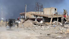 Terrified families emerge from rubble after battle of Ramadi