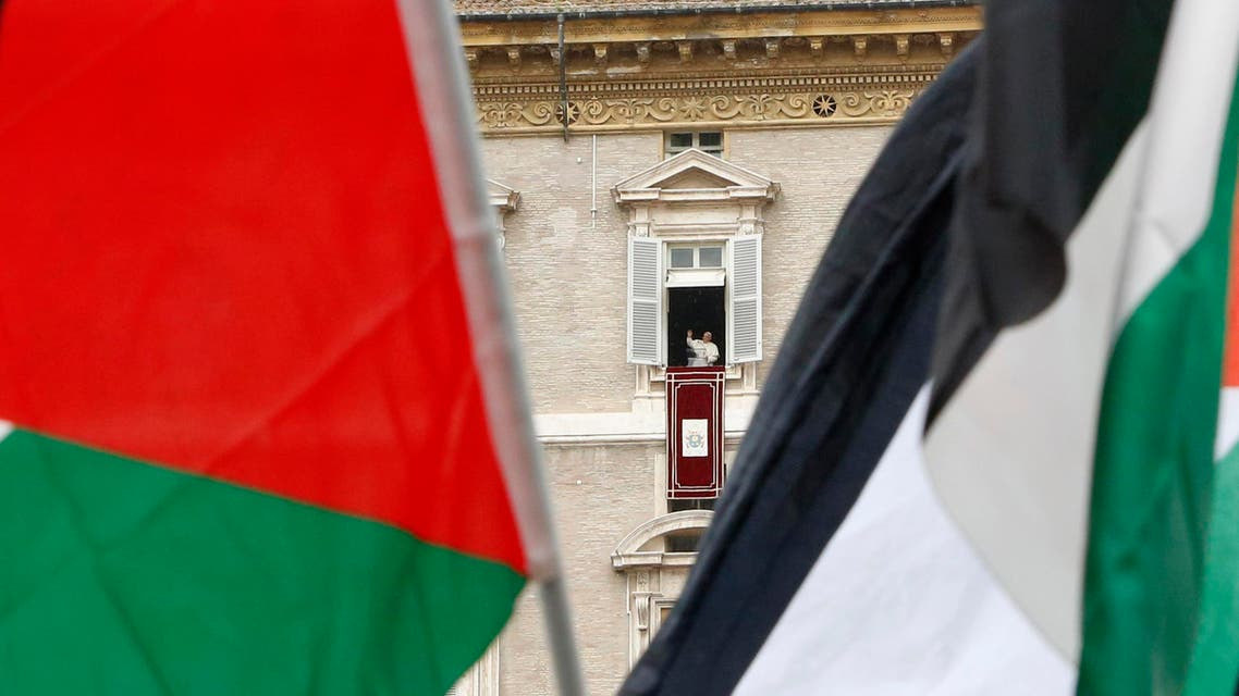 pro Palestine demonstrators wave flags as Pope Francis celebrates the Angelus noon prayer from his studio window overlooking St. Peter's square at the Vatican, Sunday, Aug. 3, 2014. (AP)