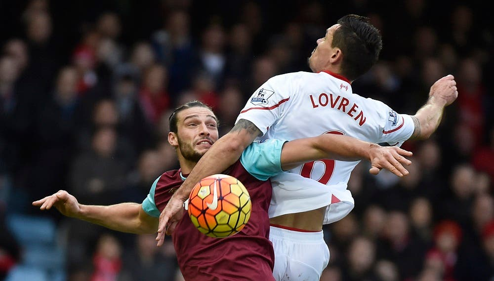 West Ham's Andy Carroll in action with Liverpool's Dejan Lovren Reuters / Toby Melville Livepic