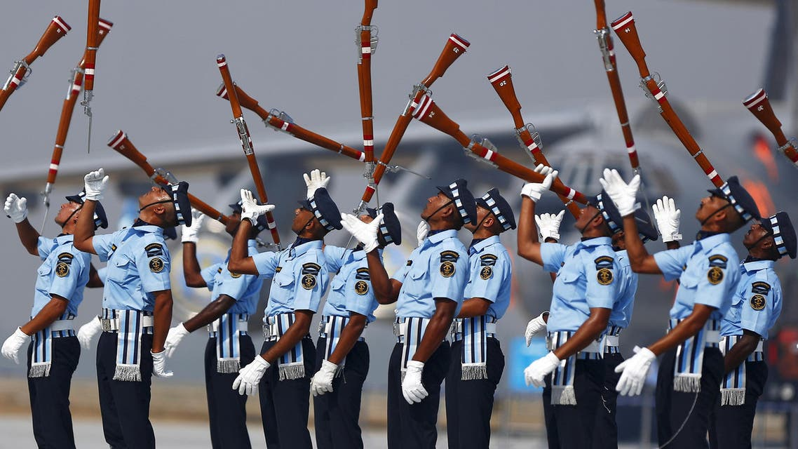 Indian Air Force soldiers toss their rifles as they perform during the full-dress rehearsal for Indian Air Force Day at the Hindon air force station on the outskirts of New Delhi October 6, 2015. (Reuters)