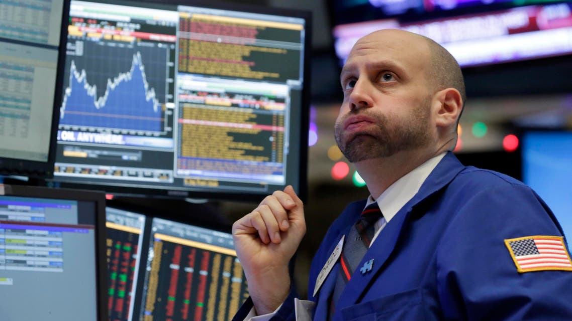 Specialist Meric Greenbaum works at his post on the floor of the New York Stock Exchange, Friday, Dec. 11, 2015.