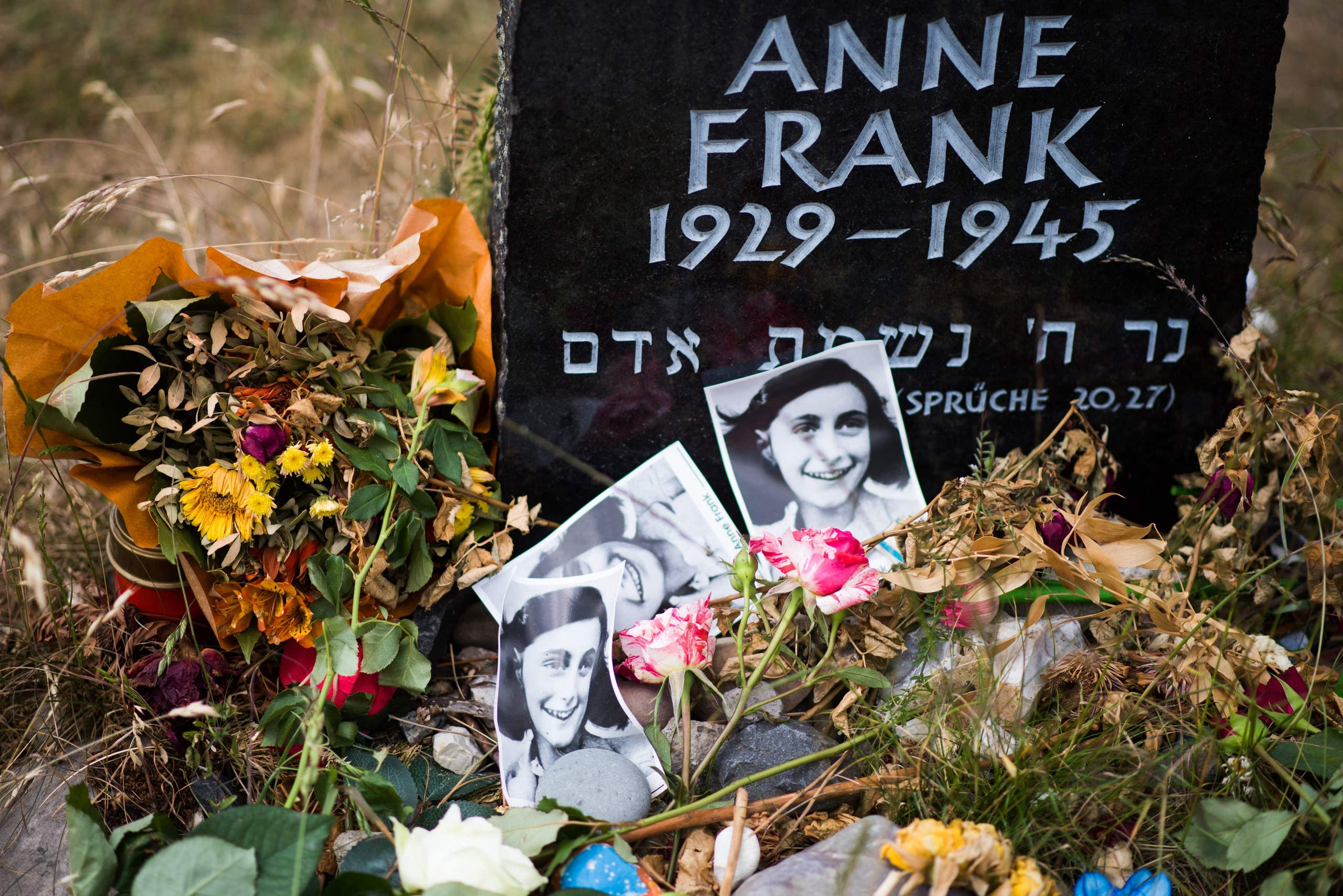 This file photo taken on June 21, 2015 shows a memorial stone for Margot Frank and Anne Frank pictured on the grounds of the former Prisoner of War (POW) and concentration camp Bergen-Belsen in Bergen, north of Hanover, central Germany. (AFP)