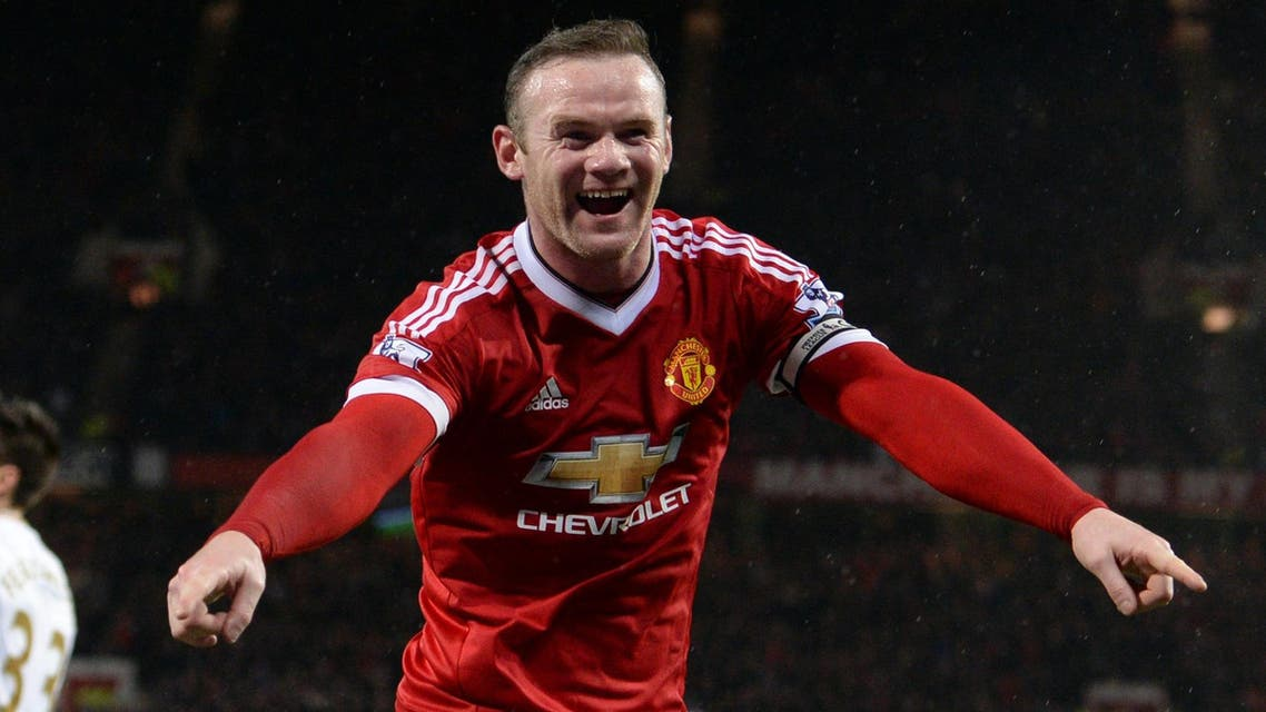 Manchester United's English striker Wayne Rooney celebrates scoring his team's second goal during the English Premier League football match between Manchester United and Swansea City at Old Trafford in Manchester, north west England, on January 2, 2016. AFP