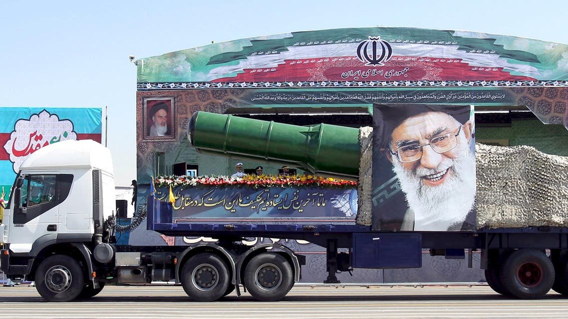 File photo of a military truck carrying a missile and a picture of Iran's Supreme Leader Ayatollah Ali Khamenei during a parade in Tehran. (Reuters)