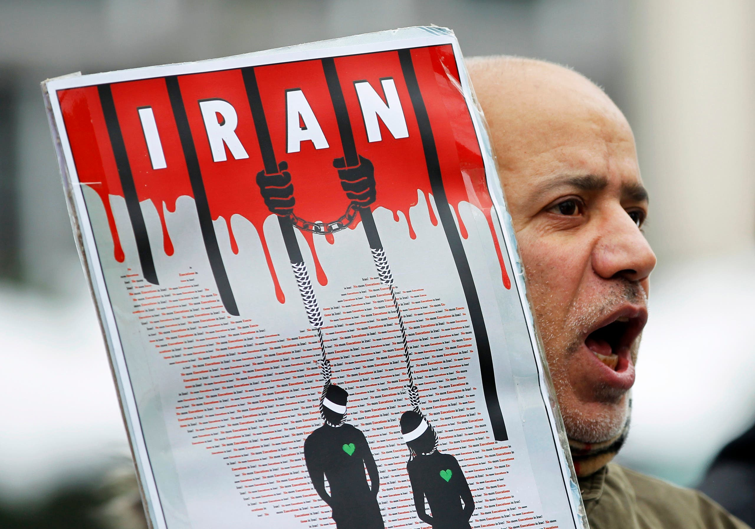 An Iranian exile shouts slogans to protest against executions in Iran during a demonstration in front of the Iranian embassy in Brussels December 29, 2010. (Reuters)