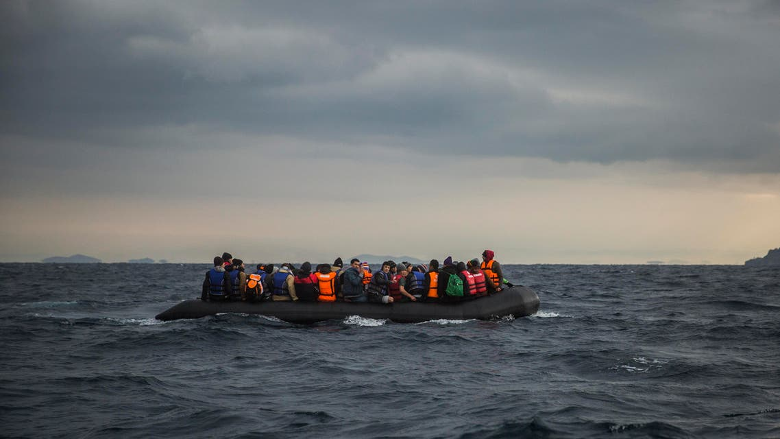 Refugees and migrants onboard a dinghy approach the Greek island of Lesbos, after crossing the Aegean sea from Turkey, Saturday, Jan. 2, 2016. More than a million people reached Europe in 2015 in the continent's largest refugee influx since the end of World War II. Nearly 3,800 people are estimated to have drowned in the Mediterranean last year, making the journey to Greece or Italy in unseaworthy vessels packed far beyond capacity. (AP Photo/Santi Palacios)