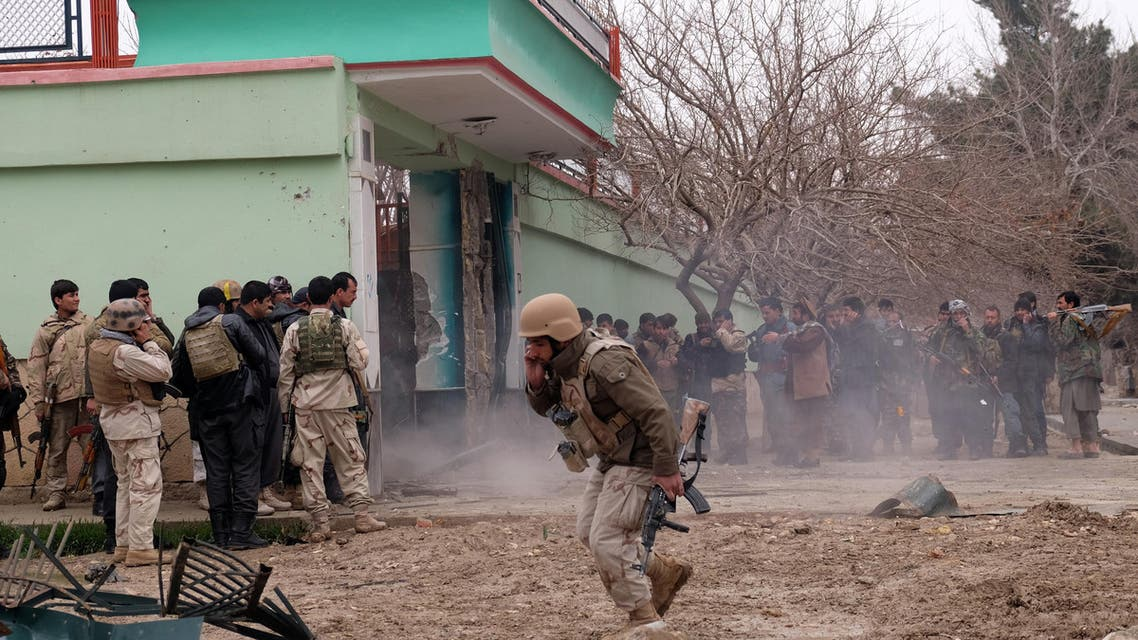 Afghan security forces surround a house which is used by a group of gunmen to attack on the Indian Consulate in Mazar-e-Sharif, capital of northern Balkh province, Afghanistan, Monday, Dec. 4, 2016. An Afghan official says heavily armed gunmen are still holed up in a building next to the Indian Consulate and that a gunbattle is underway with Afghan forces. (AP Photos/Asghar Normohammadi)