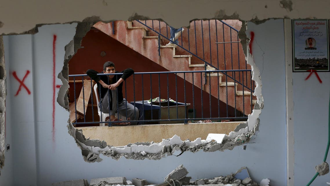 A relative looks at the demolished house of Palestinian Bahaa Mohammed Halil Allyan in the Arab east Jerusalem neighbourhood of Jabel Mukaber January 4, 2016. A spokesperson for the Israeli army said on Monday that security personnel demolished the house of Palestinian Bahaa Mohammed Halil Allyan and sealed off the house of Allah Daud Ali Abu Jamal in Jabel Mukaber. The spokesperson added that on October 13, 2015 Allyan and a second assailant shot and stabbed passengers riding a public bus killing three Jews, and Jamal killed one Jewish man in a car ramming and stabbing attack in Jerusalem. REUTERS/Ammar Awad