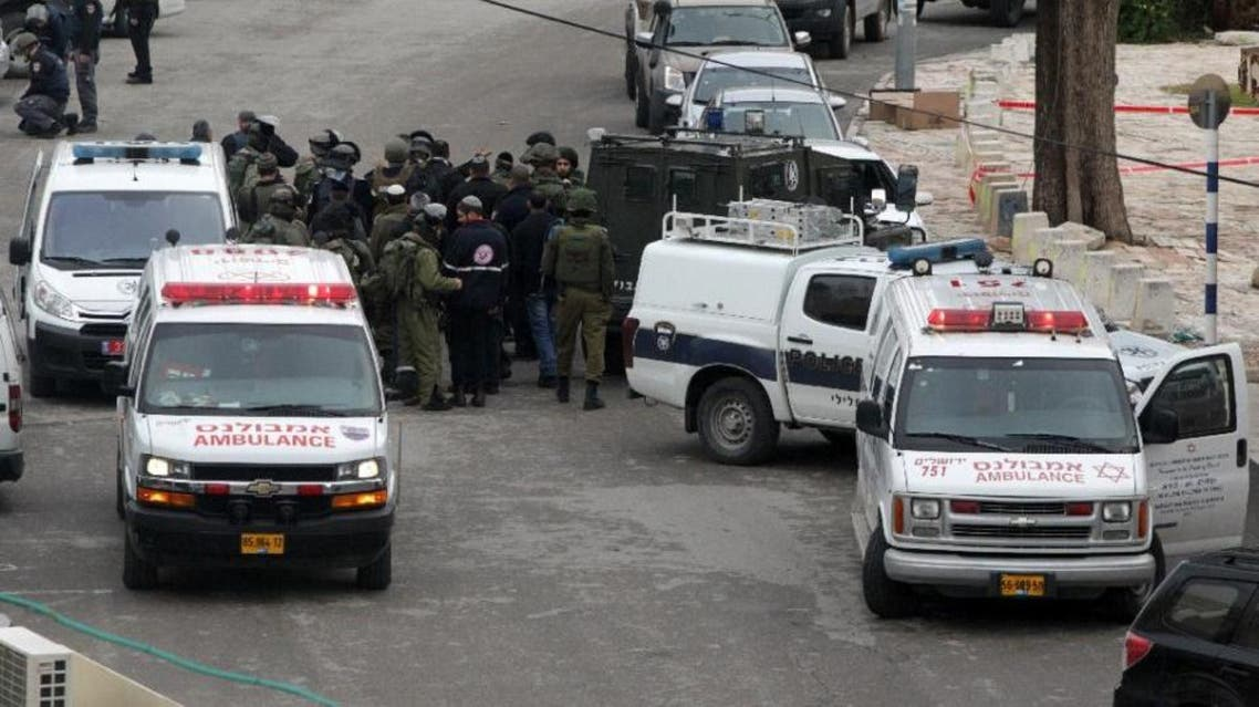Israeli soldiers gather to help a female soldier who was shot and wounded in the West Bank city of Hebron. (AFP)