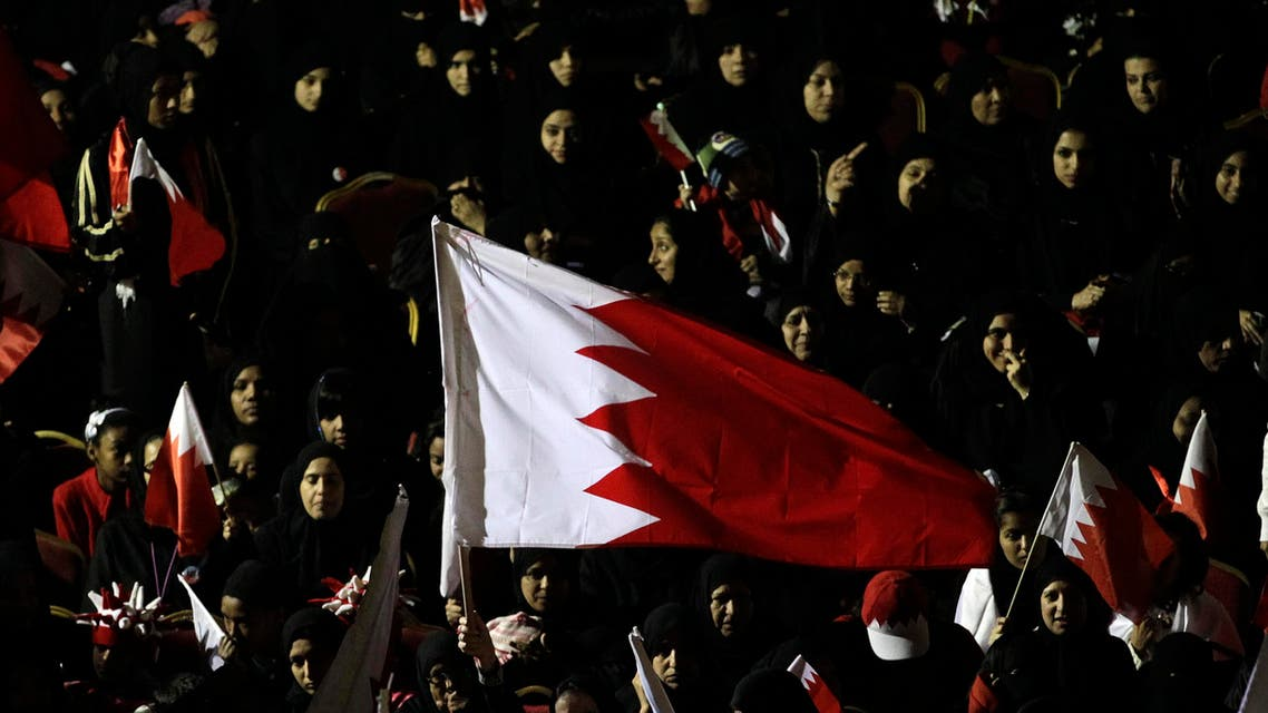 Bahraini pro-government protesters shout slogans during a march supporting the Bahraini leadership in Manama, Bahrain, Monday, Feb. 21, 2011. (AP Photo/Hassan Ammar)