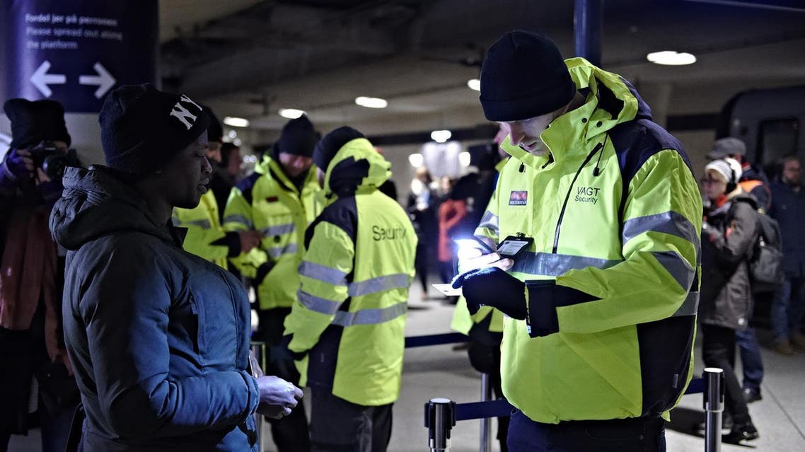 A passenger has her ID checked at the train station Copenhagen International Airport in Kastrup to prevent illegal migrants entering Sweden on Monday Jan. 4, 2016. (AP)