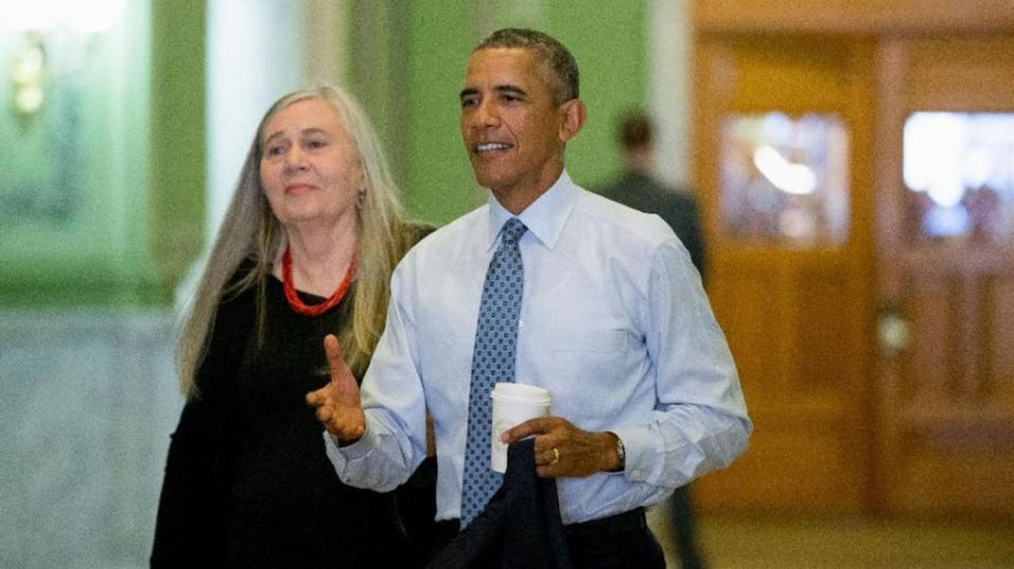 President Barack Obama, accompanied by Pulitzer Prize-winning Iowa writer Marilynne Robinson, arrives at the State Library of Iowa in Des Moines. (AP)