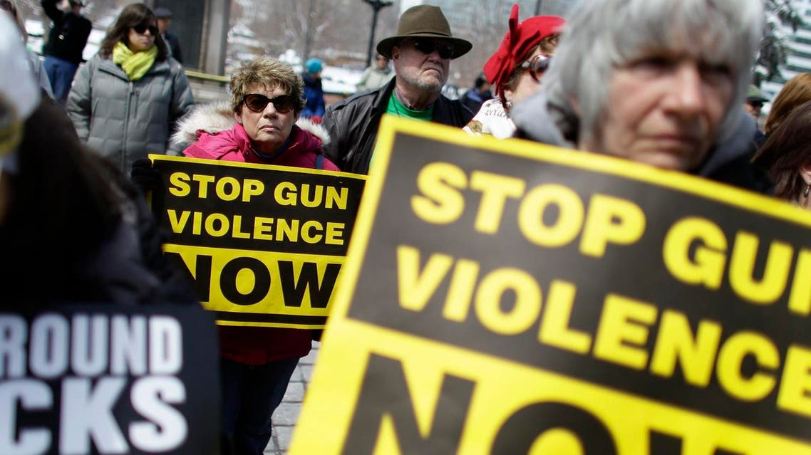 Community gun safety advocates and members of the public hold signs during a rally and vigil to honor victims of gun violence on the steps of the Colorado State Capitol, in Denver. (File photo: AP)