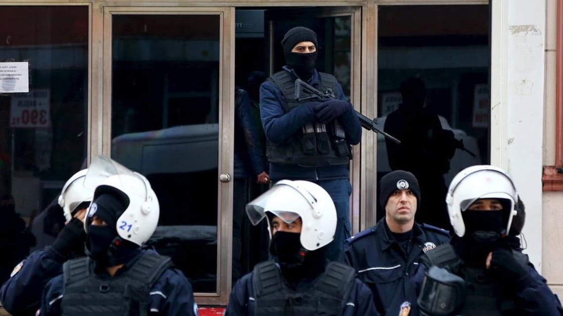 Turkish riot police stand guard outside the pro-Kurdish Democratic Regions Party (DBP) headquarters in the southeastern city of Diyarbakir, Turkey, January 5, 2016 | Reuters