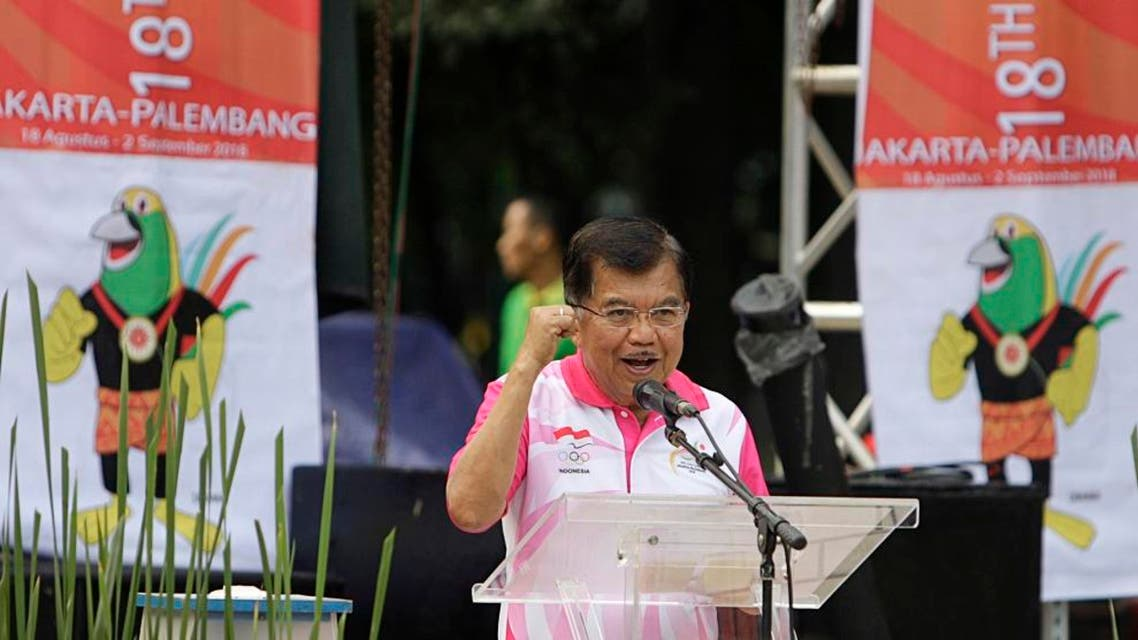 In this Dec. 27, 2015 photo, Indonesian Vice President Jusuf Kalla delivers his speech as banners with Asian Games mascot, called Drawa, stand in the background in Jakarta, Indonesia. Indonesia is revising the mascot for the 2018 Asian Games after the newly unveiled bird-of-paradise is derided by netizens. Gatot Dewa Broto, a senior official at the Ministry of Youth and Sport said Tuesday, Jan. 5, 2016, the revision of the mascot is expected to be finalized within between two and four months. (AP Photo)