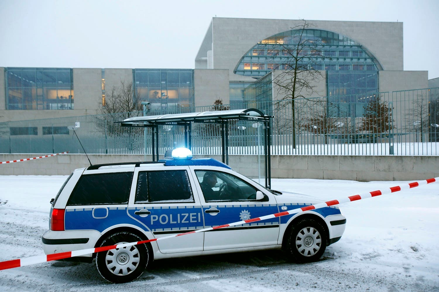 A police car is parked in front of the chancellory in Berlin. (Reuters)