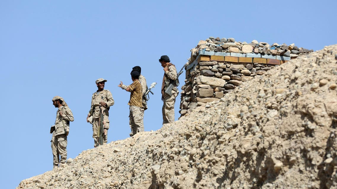 Soldiers loyal to Yemen's President Abd-Rabbu Mansour Hadi stand at their position in Majaz district of Yemen's northwestern provinceo of Marib after the pro-Hadi forces took it from Houthi rebels. (Reuters)