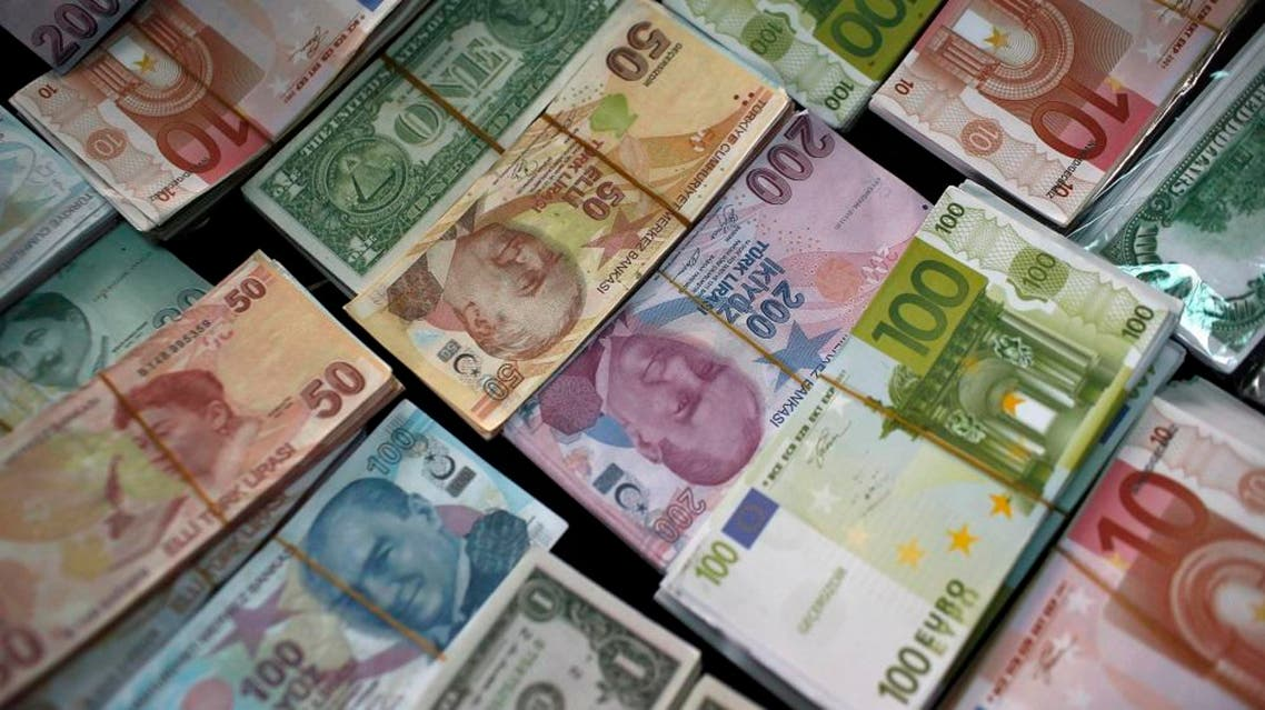 In this Monday, June 8, 2015 file photo, Turkish Liras, Euros and U.S. Dollars are stacked at a currency exchange office in Istanbul, Turkey. In emerging markets worldwide, currencies are plunging over fears that developing economies are on the verge of a crippling fall. The damage has spilled across oceans. The Dow Jones industrials plunged 328 points, nearly 2 percent, in early-afternoon trading Friday, Aug. 21, 2015 on top of a 358-point drop Thursday. (AP Photo/Emrah Gurel)