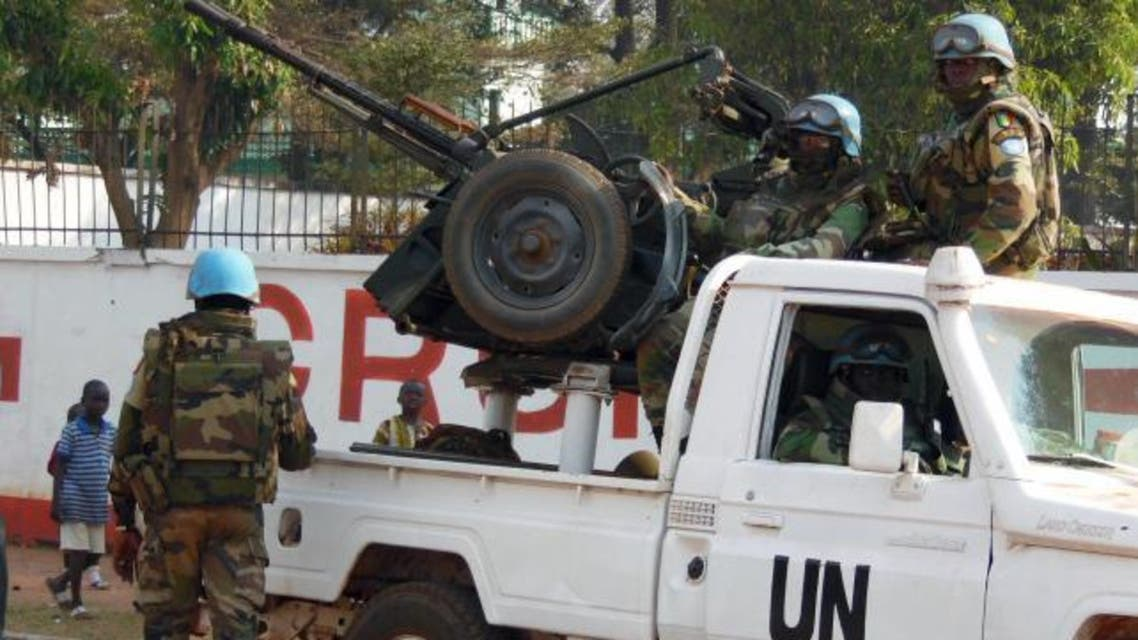 U.N. peacekeepers take a break as they patrol along a street during the presidential election in Bangui, the capital of Central African Republic, December 30, 2015. (Reuters)