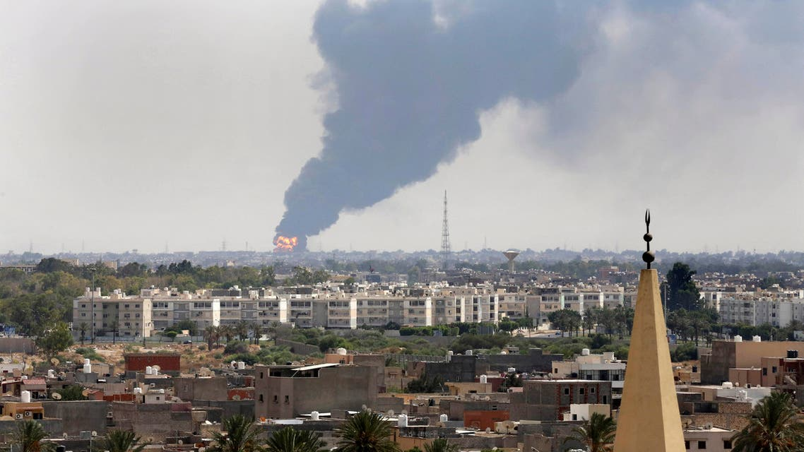 A file photo shows black smoke over the skyline of Tripoli, Libya as a fire at an oil depot rages out of control after being struck in the crossfire of warring militias. (AP)