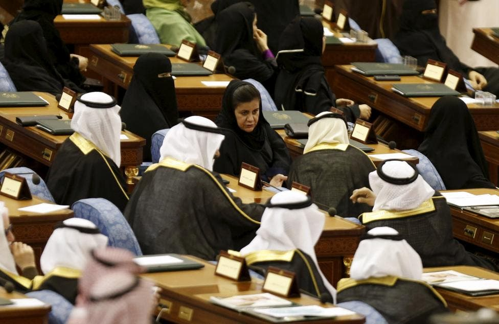 Saudi women and men, members of the Saudi Shura Council, attend a session chaired by Saudi Arabia's King Salman, in Riyadh December 23, 2015. (Reuters)