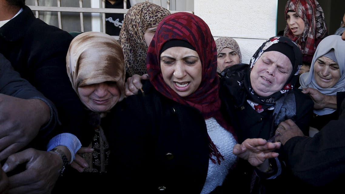Relatives of Palestinian Ishaq Badran, who allegedly carried out an attack against Israelis, mourn during his funeral, after his body was released by Israel, in the West Bank city of Ramallah. (Reuters)