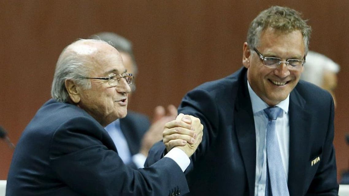 FIFA President Sepp Blatter (L) and Jerome Valcke, Secretary General of the FIFA do a Handshake For Peace at the 65th FIFA Congress in Zurich, Switzerland, in this May 29, 2015 | Reuters