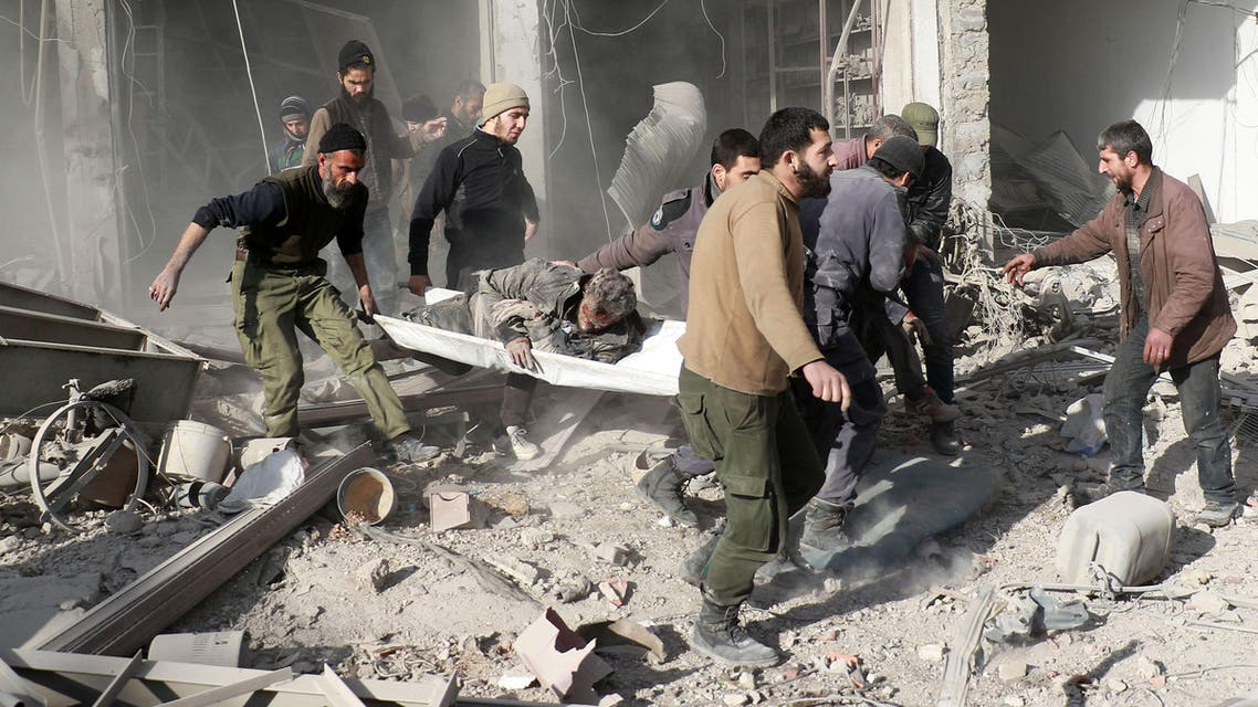 Syrians evacuate a wounded man on a stretcher following a reported airstrike by Syrian government forces in Damascus' rebel-held suburb of Zamalka, on January 6, 2016. afp