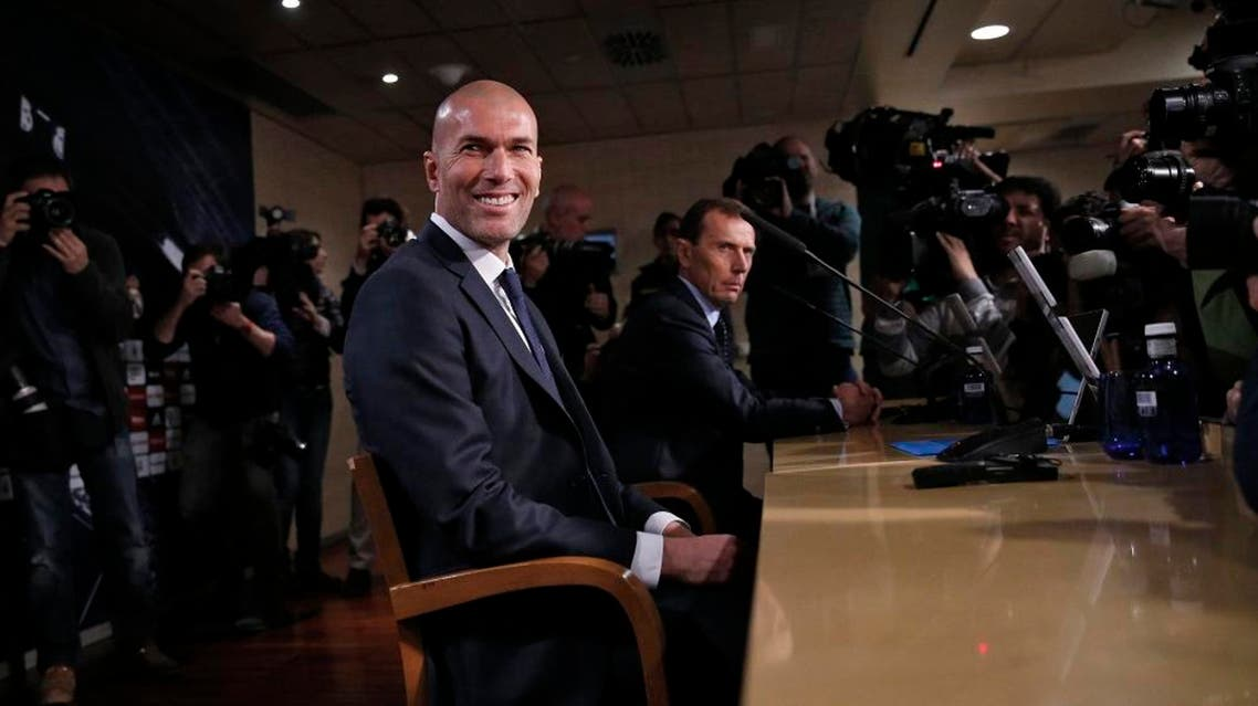 Real Madrid's new coach Zinedine Zidane reacts as he arrives to a news conference at Santiago Bernabeu stadium in Madrid, Spain, January 5, 2016   Reuters
