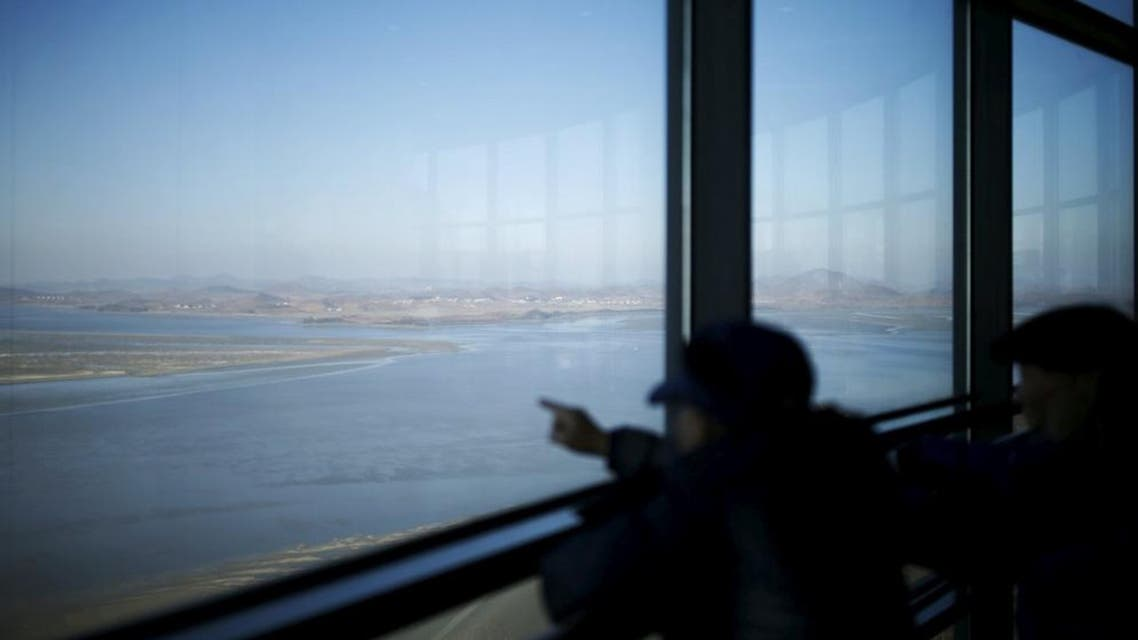 Men look towards North Korea's propaganda village Kaepoong at the Unification Observation Platform, near the demilitarized zone (DMZ) which separates the two Koreas, in Paju, South Korea, January 7, 2016 | Reuters