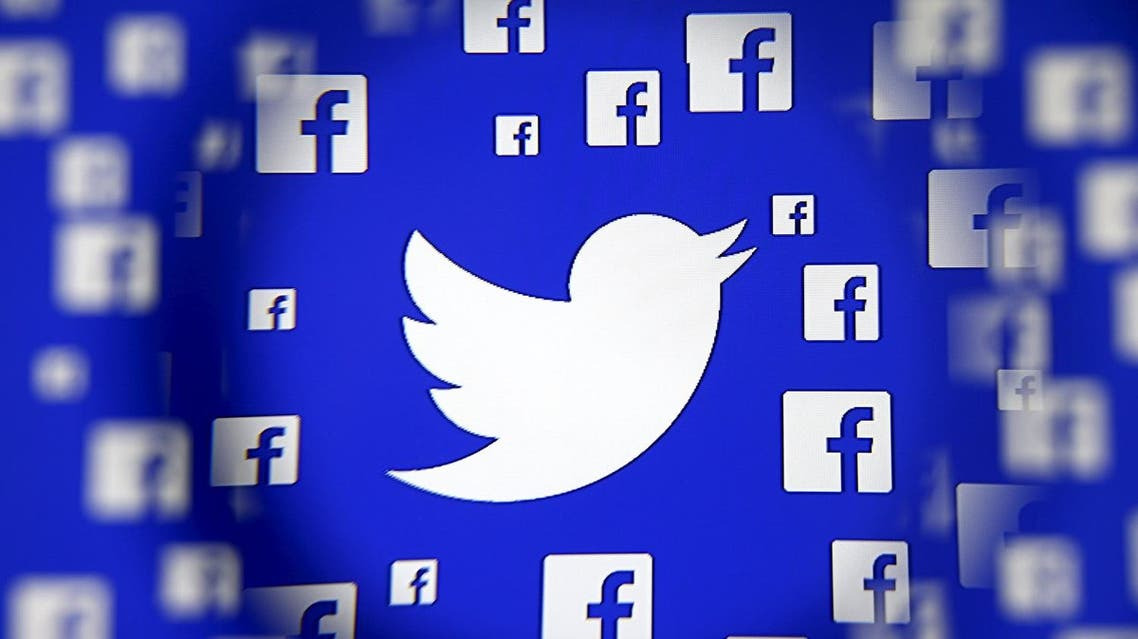 Logo of the Twitter and Facebook are seen through magnifier on display in this illustration taken in Sarajevo. (Reuters)