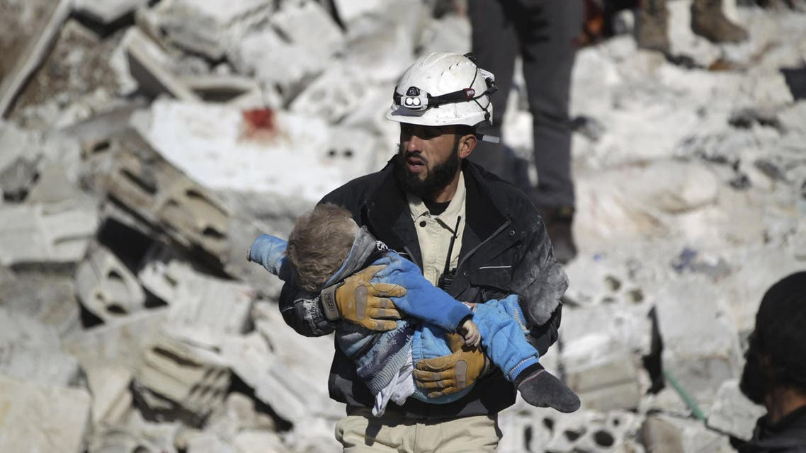 ATTENTION EDITORS - VISUAL COVERAGE OF SCENES OF DEATH AND INJURY A civil defence member carries a dead child in a site hit by what activists said were airstrikes carried out by the Russian air force in the rebel-controlled area of Maaret al-Numan town in Idlib province, Syria January 9, 2016. At least 70 people died in what activists said where four vacuum bombs dropped by the Russian air force in the town of Maaret al-Numan; other air strikes where also carried out in the towns of Saraqib, Khan Sheikhoun and Maar Dabseh, in Idlib. REUTERS/Khalil Ashawi TPX IMAGES OF THE DAY
