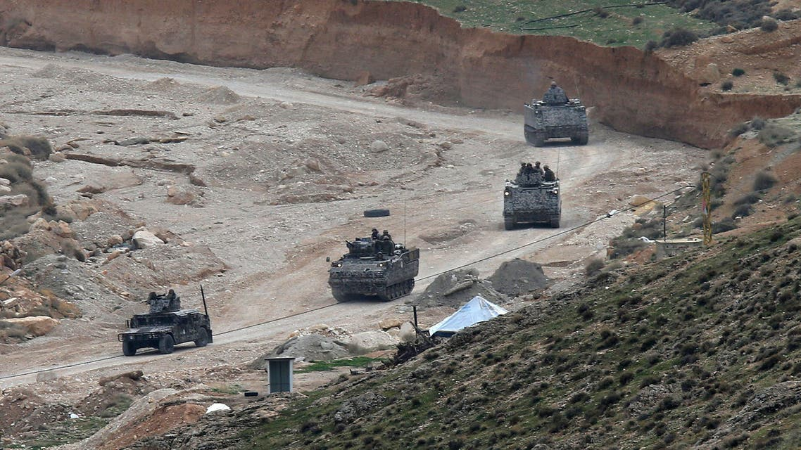 In this Wednesday, Dec. 3, 2014 file photo, Lebanese army special forces patrol in armored personnel carriers near the area where militants ambushed Lebanese soldiers, in Ras Baalbek town, eastern Lebanon. (AP)