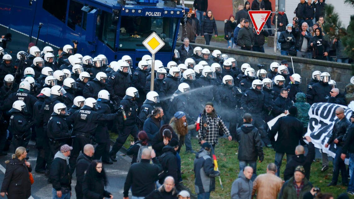 Police use pepper spray against supporters of anti-immigration right-wing movement PEGIDA (Patriotic Europeans Against the Islamisation of the West) during a demonstration march, in reaction to mass assaults on women on New Year's Eve, in Cologne, Germany, January 9, 2016. REUTERS/Wolfgang Rattay TPX IMAGES OF THE DAY