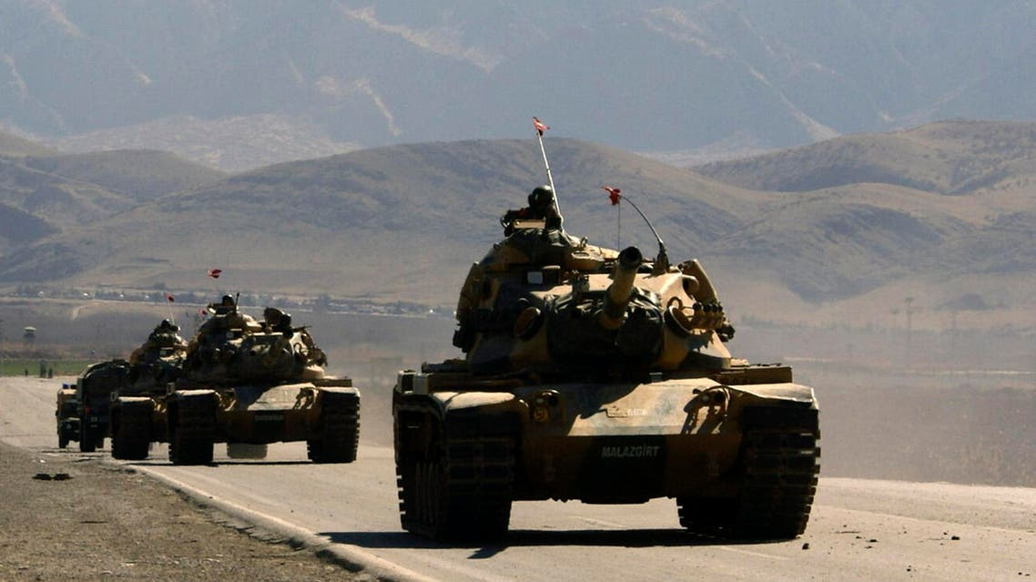 Turkish army tanks are seen near the Turkish-Iraqi border town of Silopi in the Sirnak province, southeastern Turkey, Friday, Feb. 22, 2008. AP