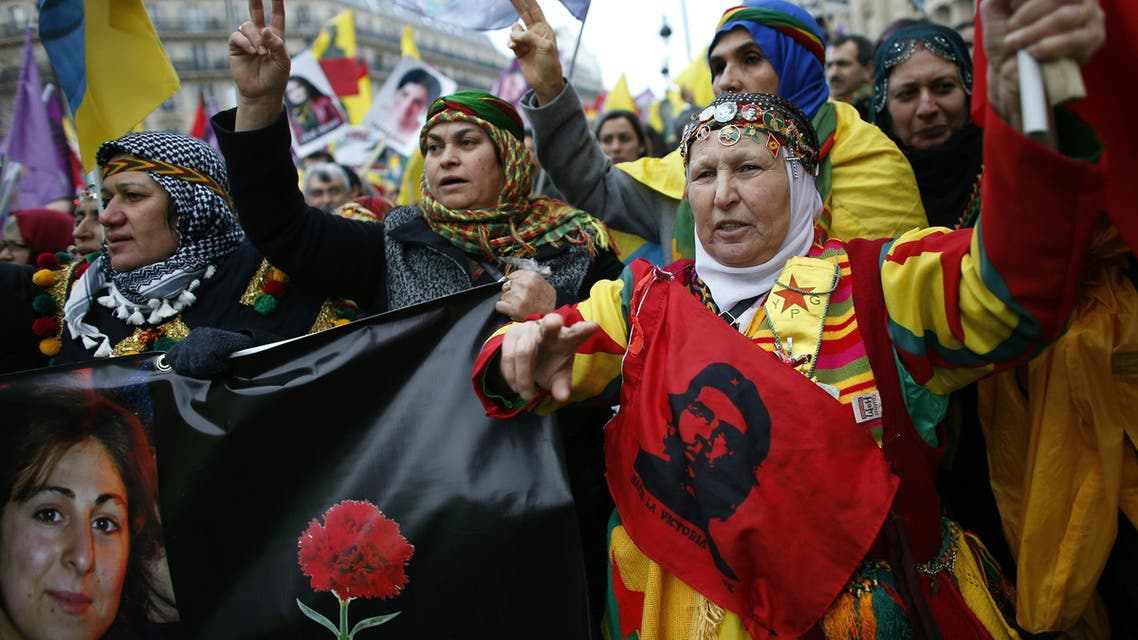 """579 - Paris : TOPSHOT - Kurdish women shout slogans while demonstrating in Paris on January 9, 2016, to commemorate the killing of the three top Kurdish activists Sakine Cansiz, Fidan Dogan and Leyla Soylemez and to ask for """"justice"""". The three women were shot to death on January 9, 2013 at the Kurdish Information Centre in Paris. The motive of the triple killing remains unclear even-though investigators suspected an implication of Turkey's secret services. / AFP / THOMAS SAMSON"""