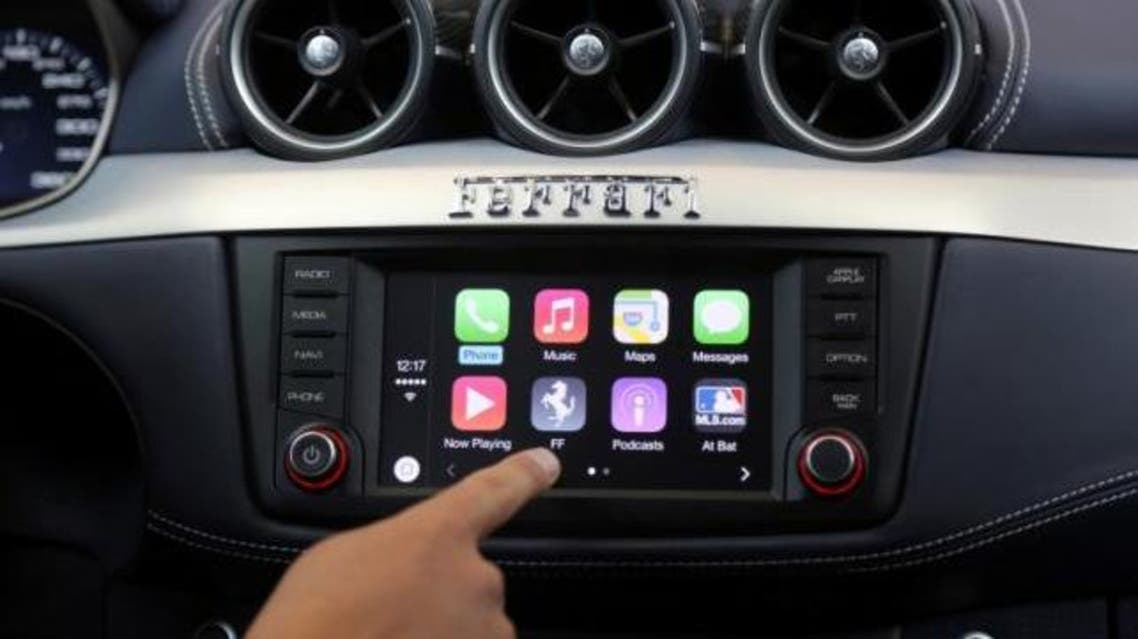 Apple's Stephen Chick displays the CarPlay program at the Worldwide Developers Conference in San Francisco, California June 2, 2014. (Reuters)
