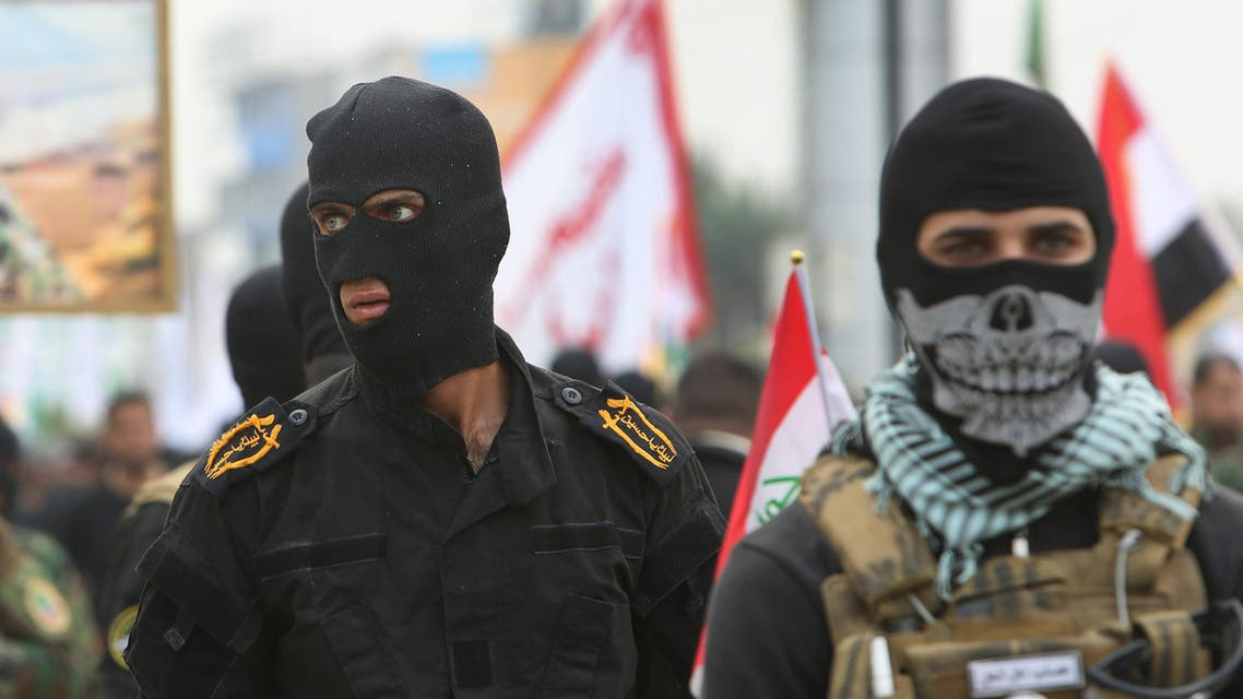 Masked Shiite militiamen attend a demonstration calling for the immediate withdrawal of Turkish troops from northern Iraq, in Basra, southern Iraq, Saturday, Dec. 12, 2015. An outpouring of public anger over the Turkish troops crisis that erupted earlier this month was on display at Saturday's protests in Basra and the capital, Baghdad. Turkey has had troops near Mosul since last year but the arrival of additional troops last week sparked an uproar. (AP Photo/Nabil al-Jurani)