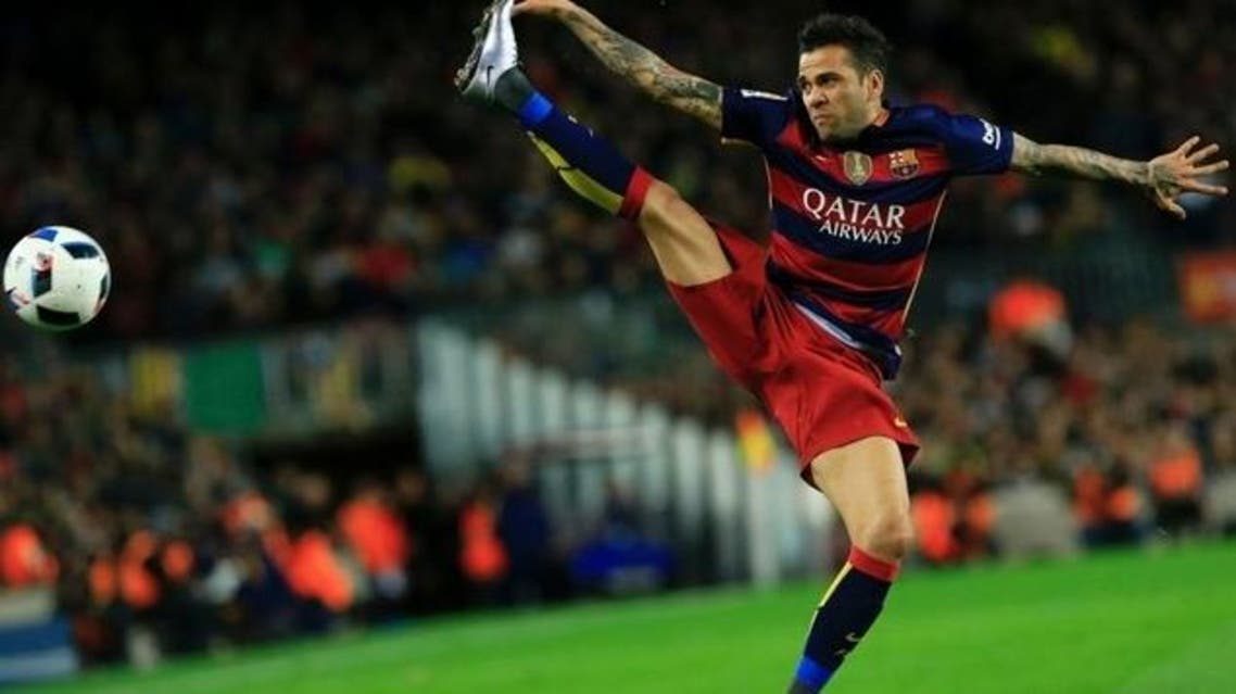 Dani Alves is unhappy about the way the media covers the Primera Liga. (AFP)