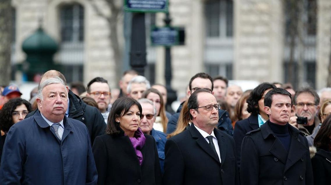 (From L) President of the French Senate Gerard Larcher, French Paris' mayor Anne Hidalgo, French President Francois Hollande and French Prime minister Manuel Valls attend a remembrance rally attended by the President of France at Place de la Republique (Republic square) on January 10, 2016 to mark a year since 1.6 million people thronged the French capital in a show of unity after attacks on the Charlie Hebdo newspaper and a Jewish supermarket. Just as it was last year, the vast Place de la Republique will be the focus of the gathering as people reiterate their support for freedom of expression and remember the other victims of what would become a year of jihadist outrages in France, culminating in the November 13 coordinated shootings and suicide bombings that killed 130 people and were claimed by the Islamic State (IS) group. / AFP / POOL / YOAN VALAT