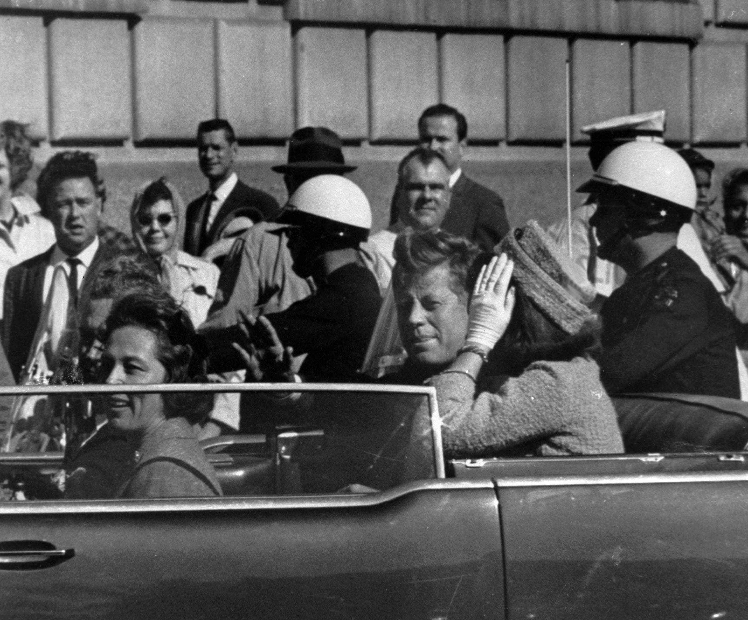 President John F. Kennedy is seen riding in motorcade approximately one minute before he was shot in Dallas, Tx., on Nov. 22, 1963. (File photo: AP)