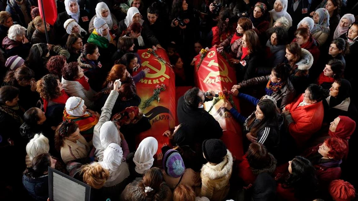 People carry the coffins of Sirin Oter and Yeliz Erbay, two women killed during security operations on Tuesday, during a funeral ceremony in Istanbul, Wednesday, Dec. 23, 2015. Security forces have killed 145 Kurdish rebels in a week in southeast Turkey, news agencies reported. The government imposed curfews in the mainly Kurdish towns of Cizre, Silopi and Sur as the security forces battle militants linked to the Kurdistan Workers' Party, or PKK who have moved their fight for autonomy to some towns and city neighborhoods in southeastern Turkey. (AP Photo/Emrah Gurel)